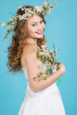 Beautiful bride with cherry wreath — Stock Photo