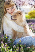 Portrait of a woman with her dog outdoors — Stock Photo