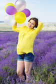 Beautiful pregnant woman in the lavender field — Stock Photo