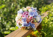 Wedding bouquet of roses and blue fresia — Stock Photo