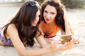 Two young girls friends together at the beach — Stock Photo