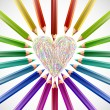 Stock Vector: Painted heart with color pencils. Vector
