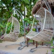 Hanging wicker chairs — Stock Photo