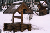 Old garden well in winter season — Foto de Stock