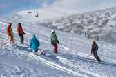 Mountain skiing view with people — Stock Photo