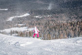 Mountain skiing view with snowboarder — Photo