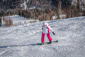 Mountain skiing view with snowboarder — Stock fotografie