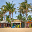 Stock Photo: Beach bungalow with coconut trees