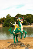 Dragon statue with people — Stock Photo