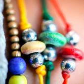 Collection colorful of bracelets on woman hand. Vector — Vecteur