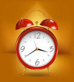 Red alarm clockwith gold details. Vector — Stok Vektör