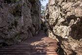 Wooden walkway between the rocks — Stock Photo