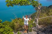View from mountain on  Angthong Marine National Park and posing woman — Stockfoto
