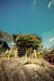 Small wood house is built on piles under rock. The summer sky of Koh Phangan — Stock Photo