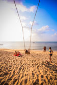 Happy lady having fun in a swing on tropical beach. Koh Phangan — Zdjęcie stockowe