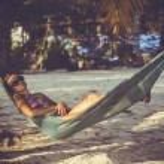 Woman in sunglasses lying at hammock by the beach. Koh Phangan — Stock Photo #48786745