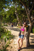 Young woman with glasses standing near the tree. Koh Phangan — Zdjęcie stockowe