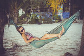 Woman in sunglasses lying at hammock by the beach. Koh Phangan — Zdjęcie stockowe
