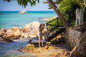 Girl photographer is on the stone beach. Phangan — Stock Photo