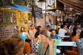 THAILAND BANGKOK MARCH 28 2013 Tourists siting by Khao San Road in Bangkok at cafe street — Stock Photo