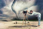 Photographer and tornado — Stock Photo
