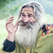 Stock Photo: Smoking old man