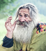 Smoking old man — Stock Photo