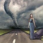 Постер, плакат: Woman and tornado