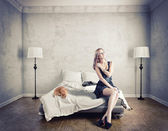 Woman on a bed — Foto de Stock