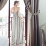 Pretty woman on a balcony — Stock Photo #25171863