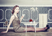Woman in little room — Stock Photo