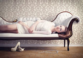 Woman on a sofa — Foto de Stock