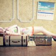 Woman, sleeping on the luggage — Stock Photo