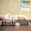 Woman, sleeping on the luggage — Stock Photo #31035559