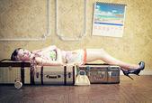 Woman, sleeping on the luggage — Stock Photo