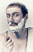 Man shaving — Stock Photo