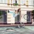Girl falling off her bicycle — Stock Photo #46134373