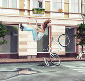 Girl falling off her bicycle — Zdjęcie stockowe