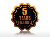 Five years guarantee starlike label — 图库照片