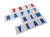 Happy new year 2013 in white tablets — Stock Photo