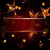 Golden stars over dark red christmas background with text space — Stock Photo