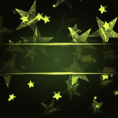 Golden stars over dark green christmas background with text spac — Stock Photo