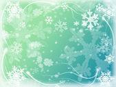 Winter background with snowflakes in blue — Stock Photo