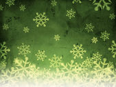 Abstract green background with snowfall — Stock Photo