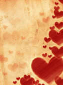 Red striped hearts on old paper — Stock Photo