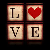 Love with red heart in 3d wooden cubes — Stock Photo