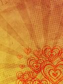 Coeurs avec rayons sur vieux papier — Photo