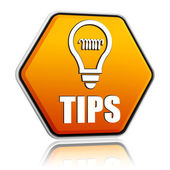 Tips and bulb symbol in orange hexagon banner — Stock Photo