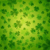 Striped shamrocks in green old paper background — Stock Photo