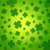 Striped four-leaved shamrocks in green old paper background — Stock Photo